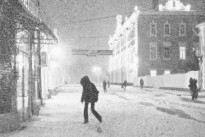 Black-and-white picture of the city street during a snow-storm.