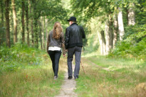Father walking with daughter in the forest