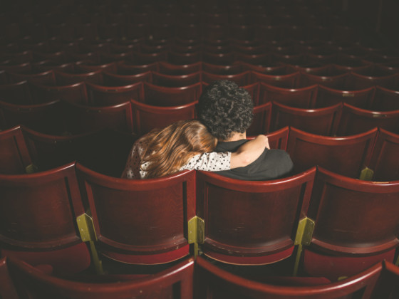 Young couple sitting in movie theater