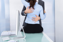 Businessman And Businesswoman Making Love