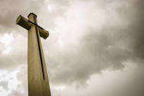 Cross in dark clounds