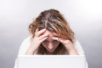 woman working on computer having headache