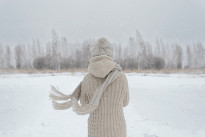 Woman on a meadow in winter