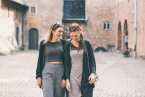 Two beautiful nordic girls visiting old fortress in Oslo